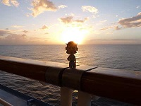 Docman watching the sun go down over Grenada whilst on a cruise ship touring the Caribbean